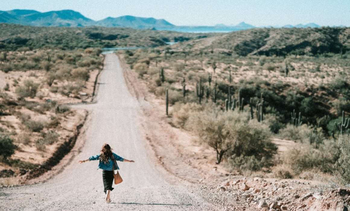 woman-walking-on-dirt-road
